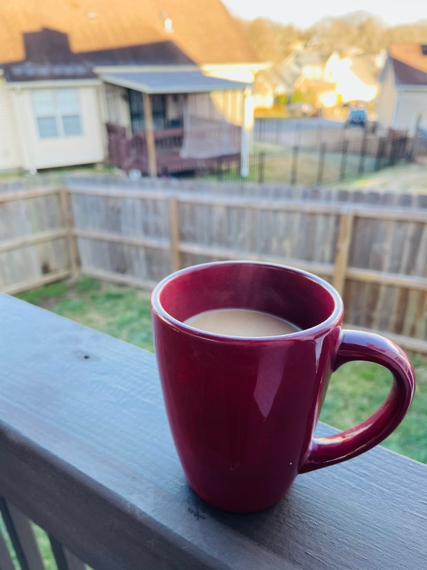 Cup of coffee outside in the morning