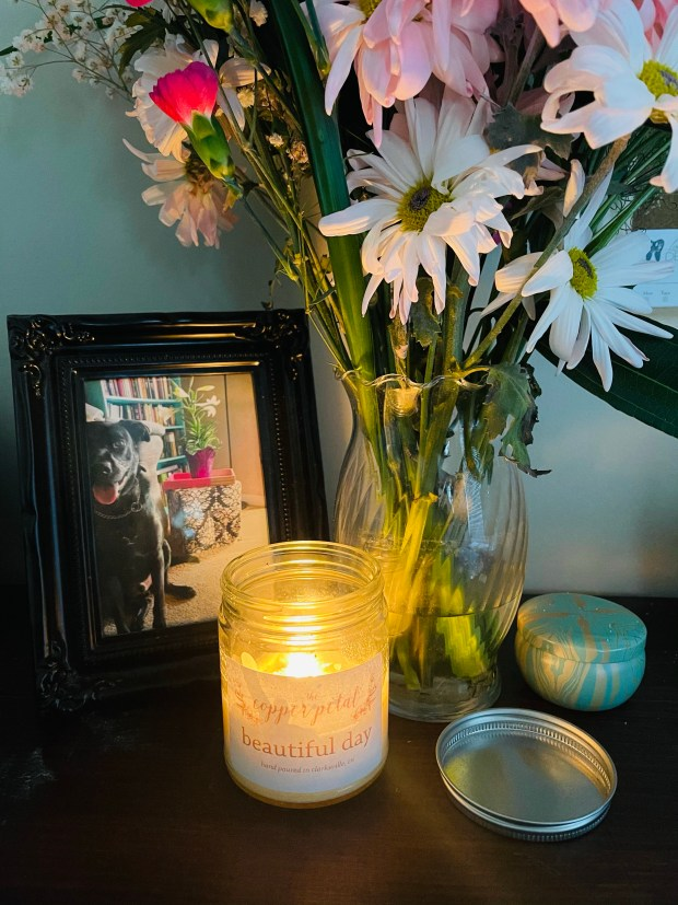 Flowers and candle in office