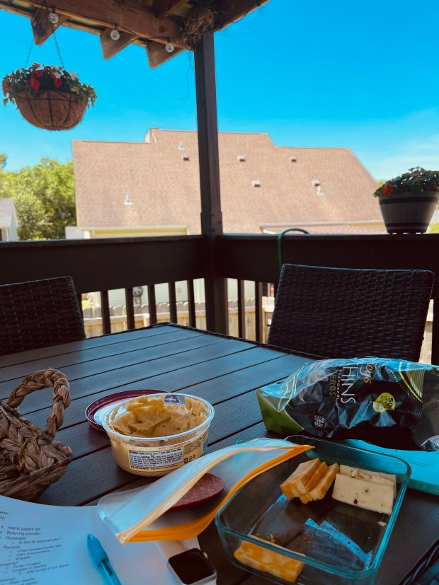 eating lunch on back deck with blue skies and flowers