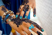 A cousin shows off her henna designs