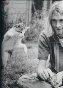 Kurt Cobain is having a good time with a friend