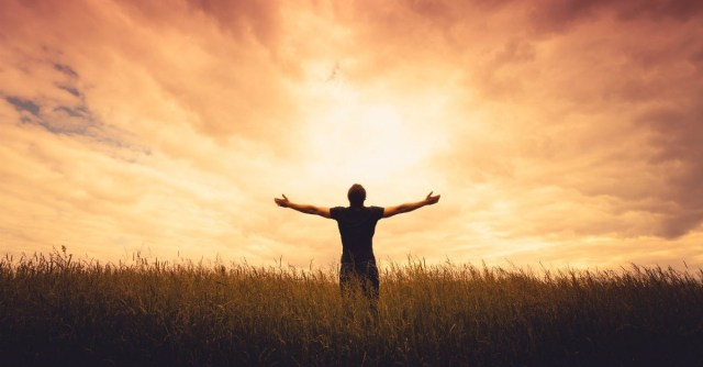 Person stretch out his hand in worship on reckless abandon