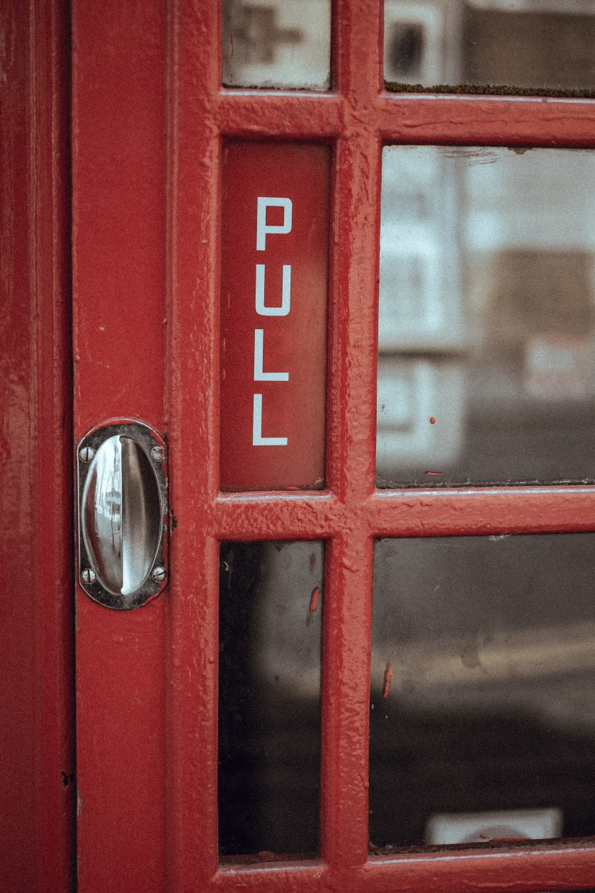 A telephone box door with pull.