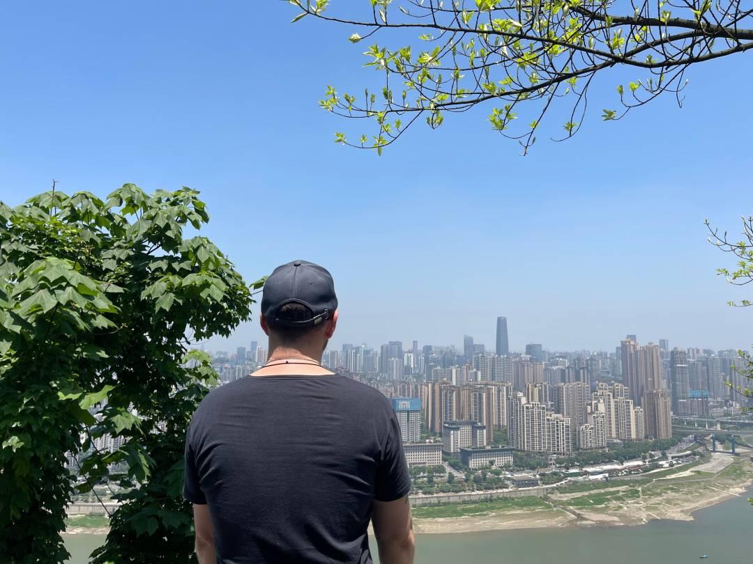 Enjoying the beautiful scenery of downtown Chongqing on the top of Nanshan.