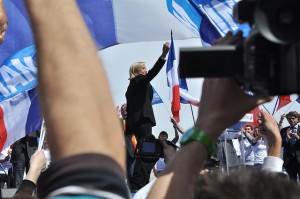 Le Pen waves to a crowd of supporters at a meeting of the FN. https://flic.kr/p/ciN3J5