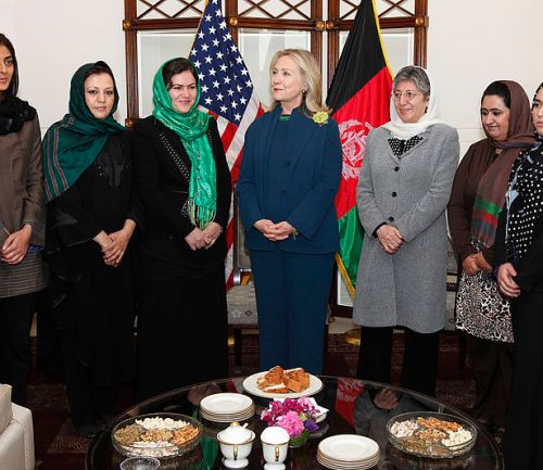 U.S. Secretary of State, Hillary Rodham Clinton, standing with female Afghan politicians in 2011