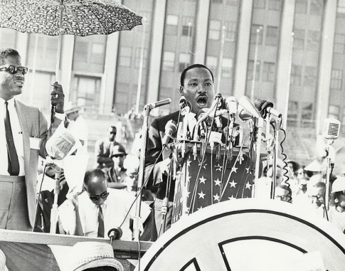 Dr. Martin Luther King Jr speaks to crowd outdoors  in Chicago
