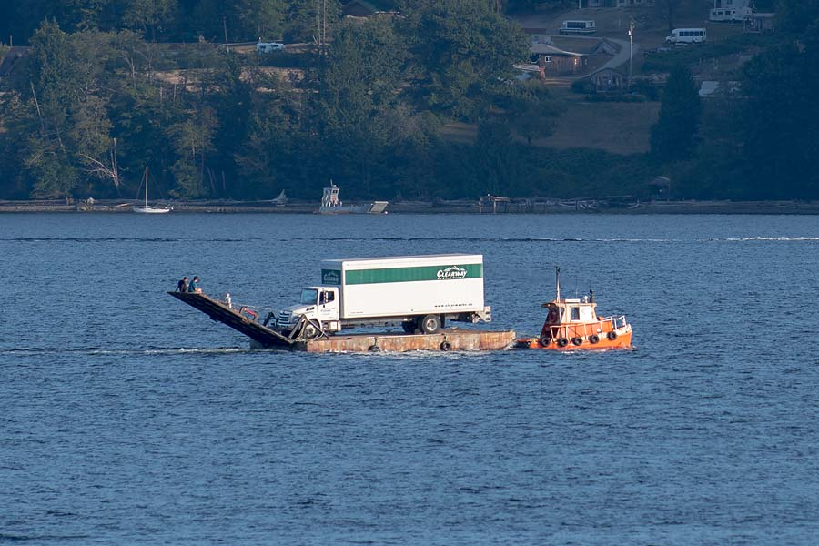 Tug towing barge