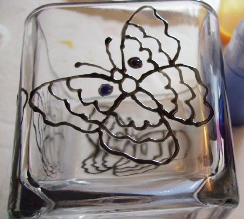 Add Pebeo sapphire paint to the dots of the butterfly.