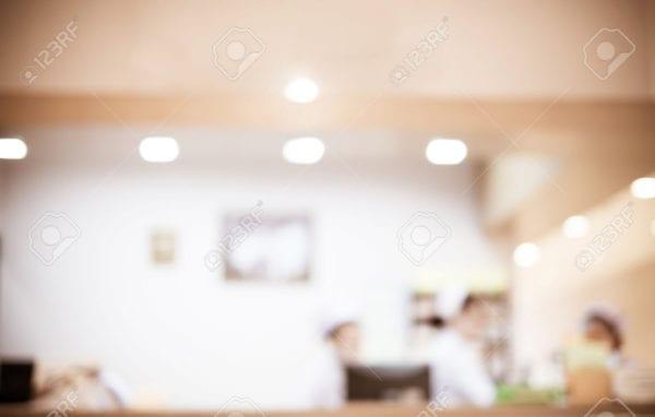 Blurred background : Vintage filter nurse at hospital counter.
