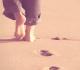 passos na praia
