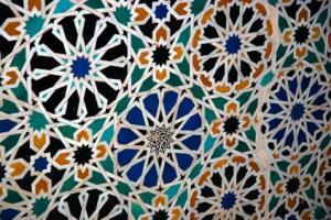 Aperiodic mosaics, such as those found in the medieval Islamic mosaics of the Alhambra Palace in Spain (shown above), have helped scientists understand what quasicrystals look like at the atomic level. In those mosaics, as in quasicrystals, the patterns are regular -- they follow mathematical rules -- but they never repeat themselves. (Credit: © cbomers / Fotolia)
