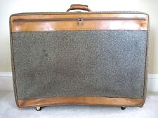 early suitcase with wheels