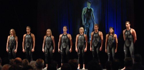 Handout photo of Michael Phelps hologram overlooking (L-R:) Bronte Barratt, Moss Burmeister, Jessica Schipper, Dean Kent, Leisel Jones, Eamonn Sullivan, Stephanie Rice and Grant Hackett at the Launch of the new Speedo futuristic swim suit in Sydney, Tuesday, Feb. 12, 2008. The Speedo LZR Racer suits are seamless and boast five per cent less passive drag than the Speedo FS-PRO which was launched just under a year ago. (AAP Image/Sportshoot, Delly Carr) NO ARCHIVING, EDITORIAL USE ONLY