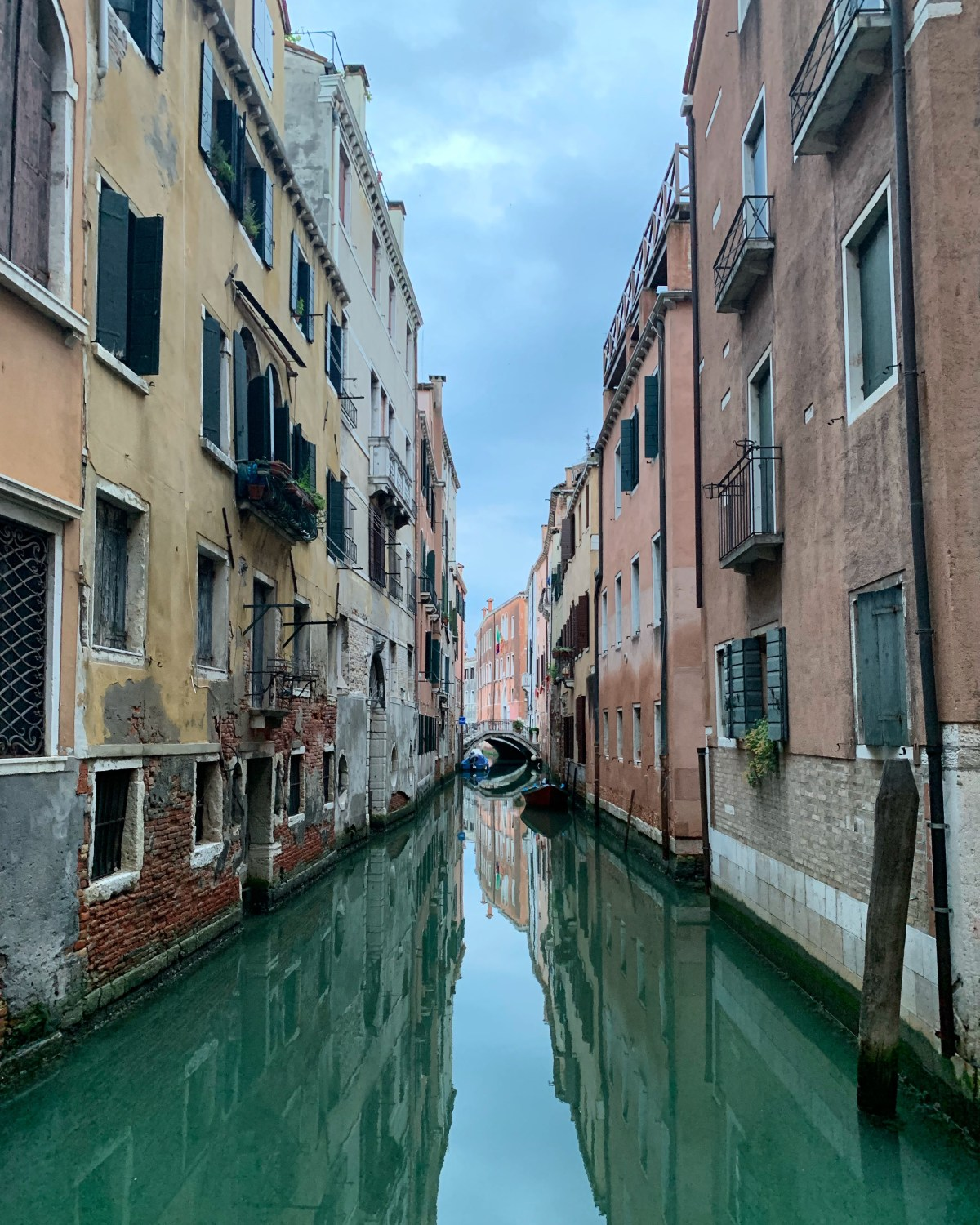 Venice canal waterway with reflection in the water