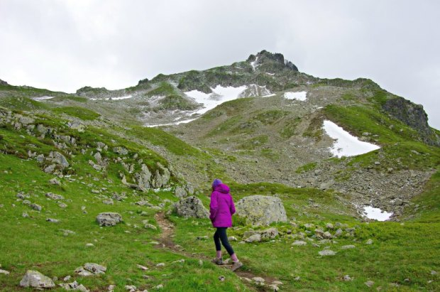 Hiking uphill in the Alps