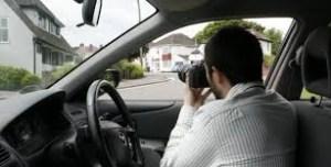 Investigator Taking Photograph