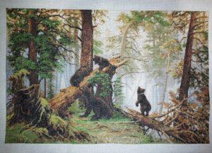 Bordado en punto de cruz con dibujo de osos en el bosque