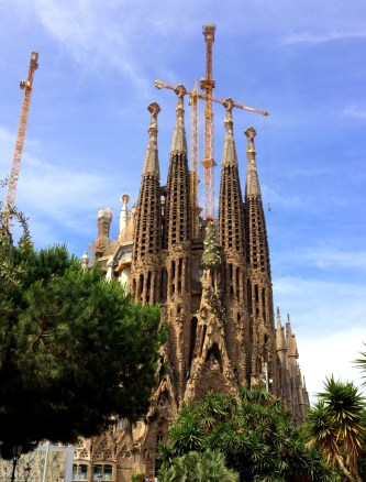 Sagrada Familia will see cranes forever, occasionally they form a cross.