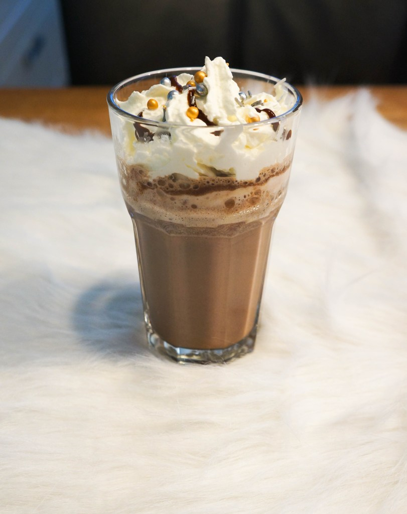 Delicious mint hot chocolate recipe christmas style with glamour sprinkles and whiped cream. Get in the winter spirit with this hot chocolate recipe #hotchocolate #winter #christmas