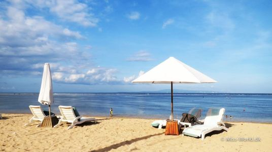 Sun chairs at the peaceful Sanur Beach Bali