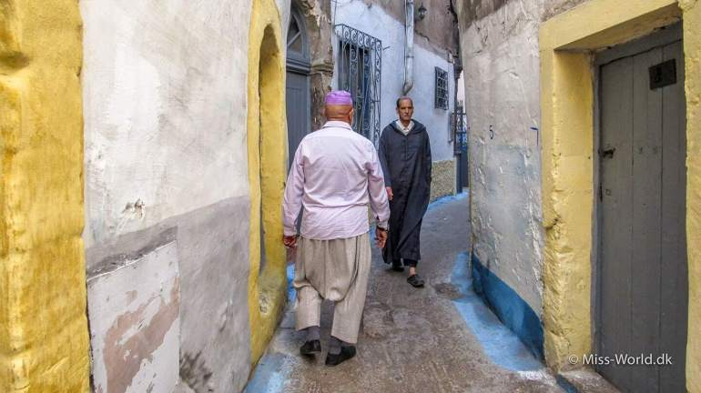Moroccan men in alley Essaouira Medina Morocco