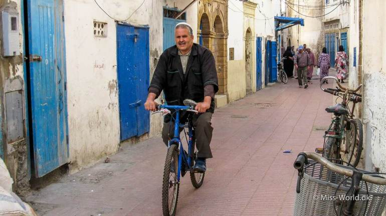 The Medina in Essaouira Morocco - Moroccan man on bike in the narrow streets of the medina