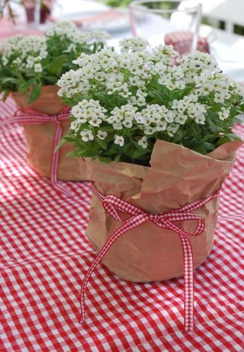 Flowers wrapped in brown parcel paper