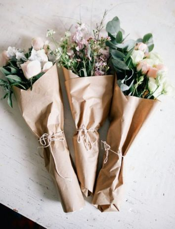 Flowers wrapped in brown paper package tied up with string!