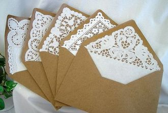 Brown paper and lace envelopes for invitations