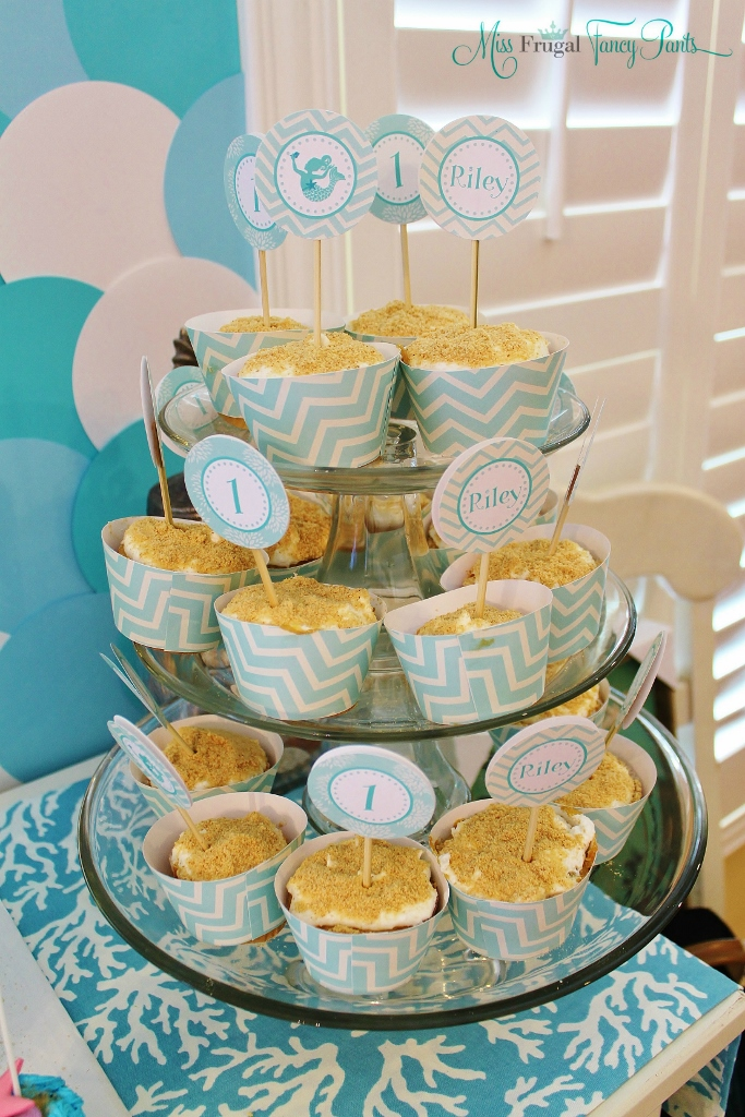 Little Mermaid Under the Sea 1st Birthday Party Decor with Aqua Cupcake Wrappers & Toppers| missfrugalfancypants.com