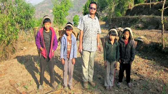 Rajendra Nhisutu and children who're missing their school life