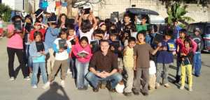 Tim giving Bibles to the students at the orphanage Fundaninos