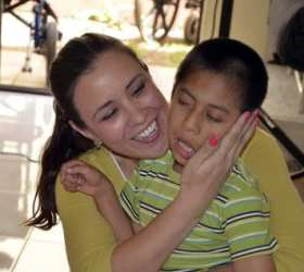 Sharie with disabled children at the Cadanino Ministry