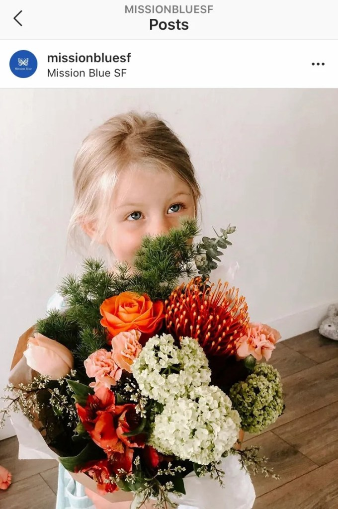 Girl holding flower bouquet