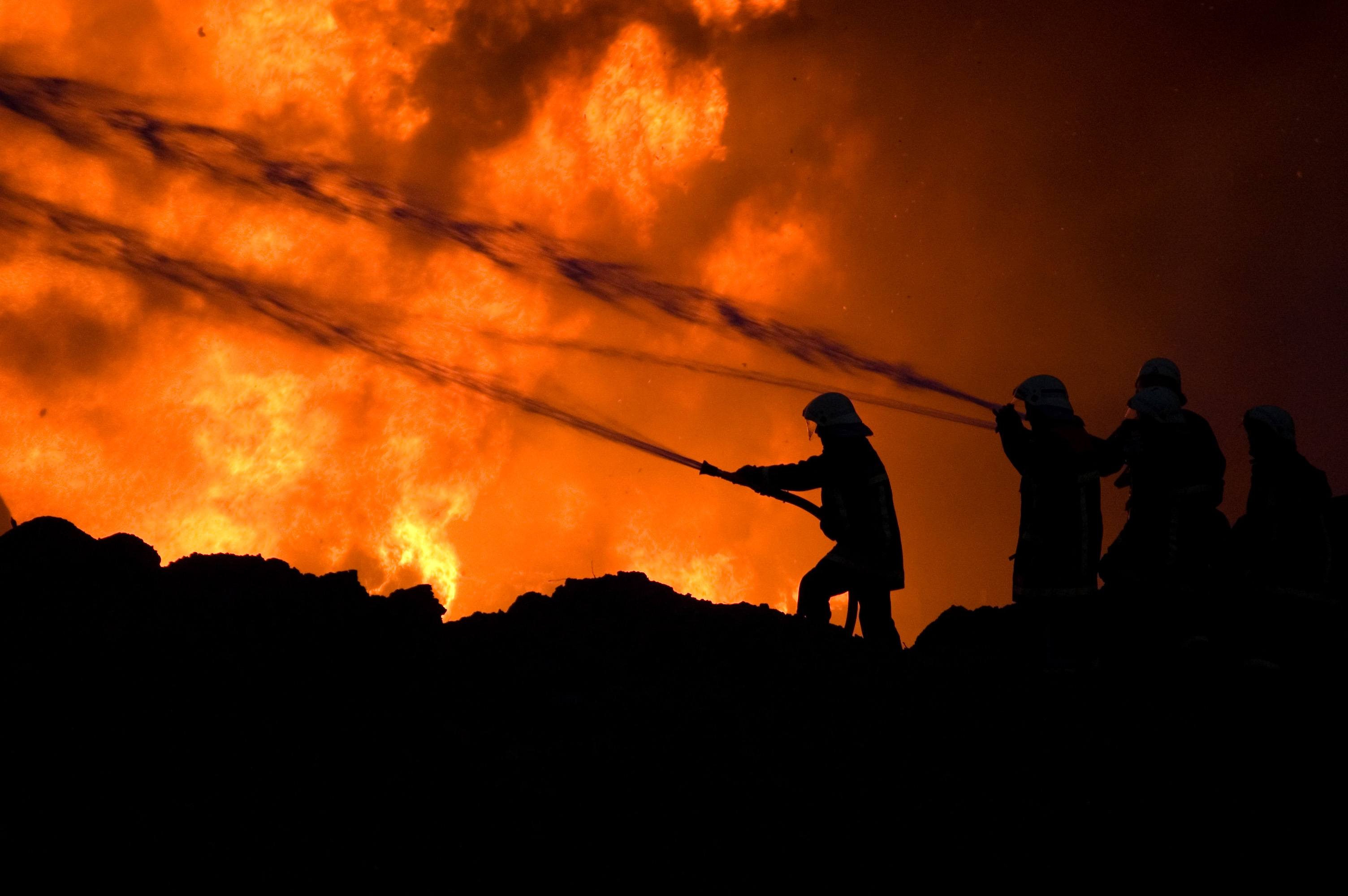Firefighters at work fighting a fire
