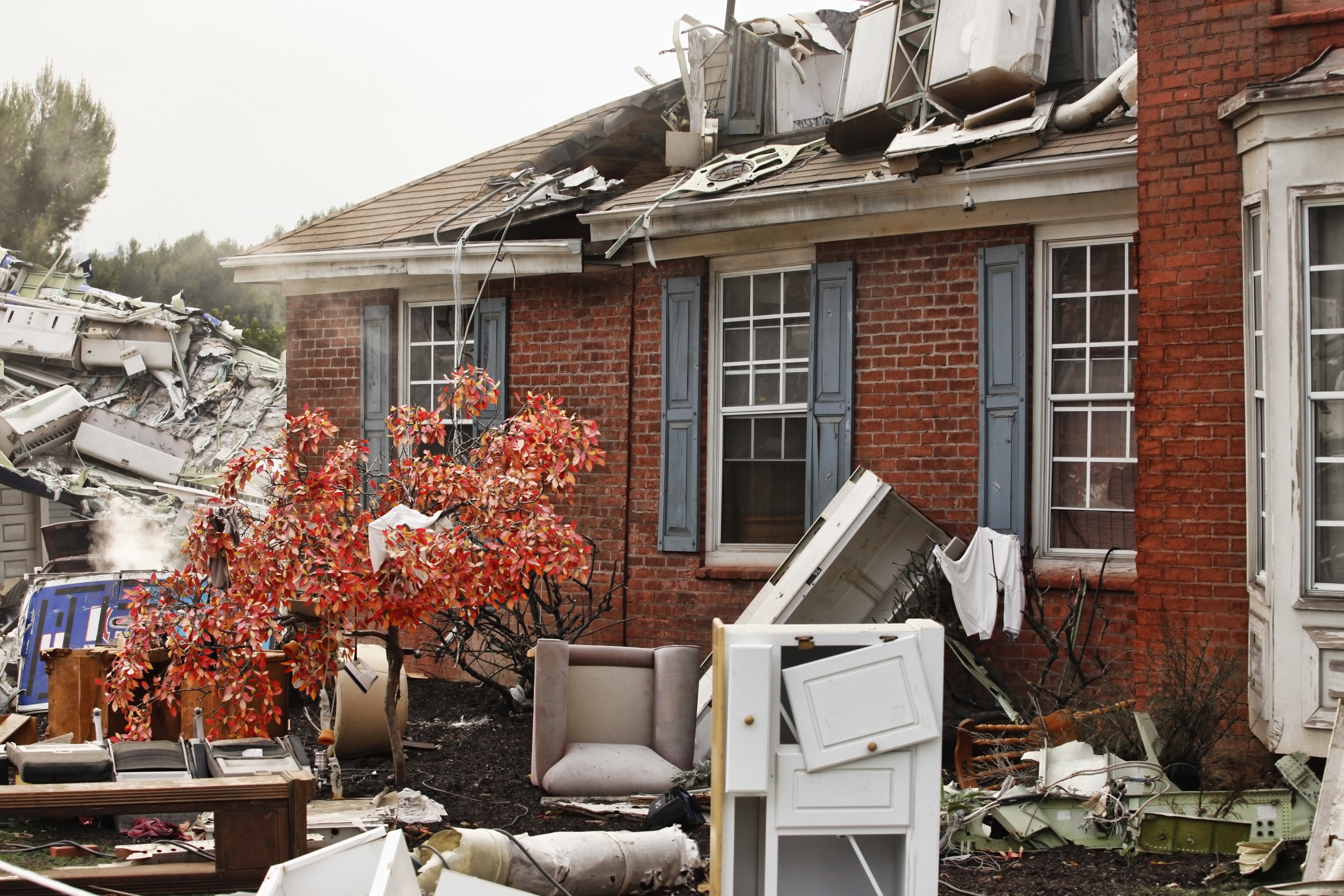 Red brick house, damaged by a natural disaster.