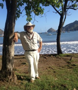 11. Bill relaxed under tropical trees near Joyful's anchorage in gorgeous Nuku Hiva.