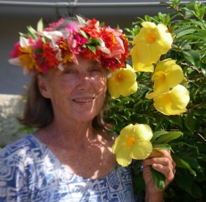 34. Anne wore the popular couronne de tete (crown of flowers) made by a local woman living in Vaitape, Bora Bora, near Joyful.  The yellow flowers were in the church garden in Vaitape, where Anne and Jeff attend church while in Bora Bora.