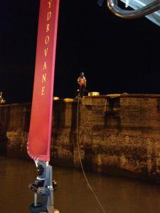 38. Joyful's land line handler walked Joyful's stern line forward to the third of the Atlantic (Gatun) locks.