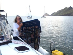 5. Anne, on Joyful's deck in the Nuku Hiva anchorage, held the Mission Joyful blanket kindly given to Jeff and Anne by the Huntsville First United Methodist Chapel attendees.  Thank you and God bless you!