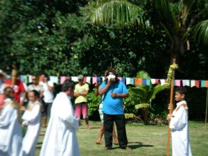 50. The Catholic church held a procession outside near the foot of Mt. Pahia.  A local man played the conch shell to praise the Lord during the procession, as he did at certain times during the church services in the sanctuary.