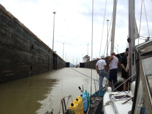85. Jeff, Bill & a line handler stood on Joyful's bow as the highest Miraflores lock doors open.