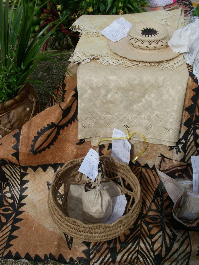 101. Bags of home grown and ground kava, hand made tapa cloth, and beautiful hibiscus woven ta'ovala compete for 1st prize at the Agricultural Show