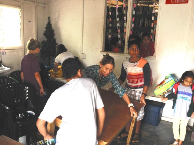 133. Beatrice, aided by Tongan children, arrange one of a few tables in preparation for the art class. Beatrice, Gabriella, Jeff and Abby helped Anne instruct the art lesson about Jesus to over 60 children