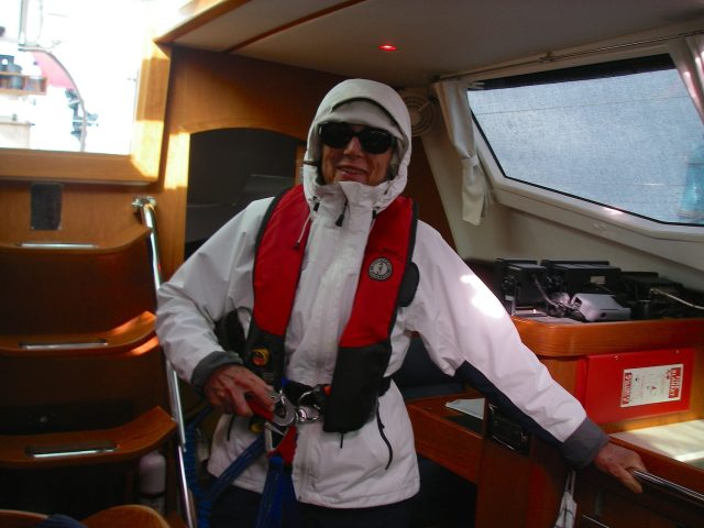 14. Anne was ready to go on watch during the day in rough seas wearing her light weight foul weather gear. She wore her ocean racing foul weather gear for extra rough seas and:or for cold days and nights at sea.  Most passages had moderate conditions