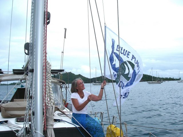 44. Anne hoisted Joyful's new Blue Planet Odyssey flag she made to take the place of the original wind shreaded BPO flag.