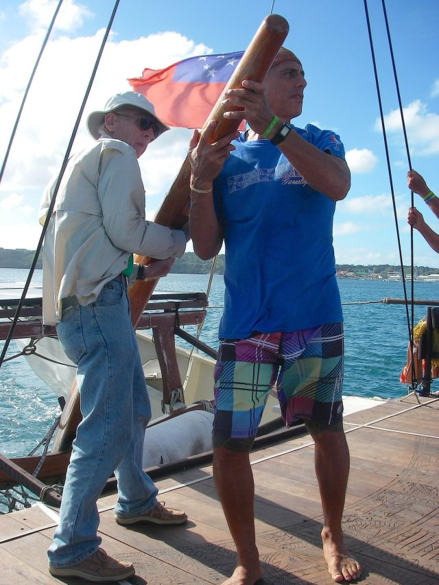 85. Jeff and a Tongan at the tiller. It took great strength to operate the tiller during certain maneouvers