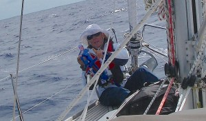 20. Flat Mr. Davis is very happy that Anne, while on the foredeck, is clipping her safety harness tether onto Joyful's portside jackstays. Flat Mr. Davis is attached to Anne's jacket and feels very secure