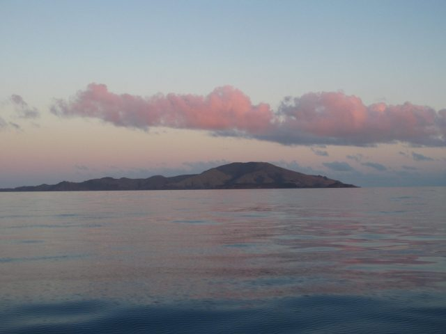 56-at-sunrise-an-island-in-the-great-barrier-reef-as-seen-from-the-hydrographers-passage-on-passage-from-vanuatu-to-mackay